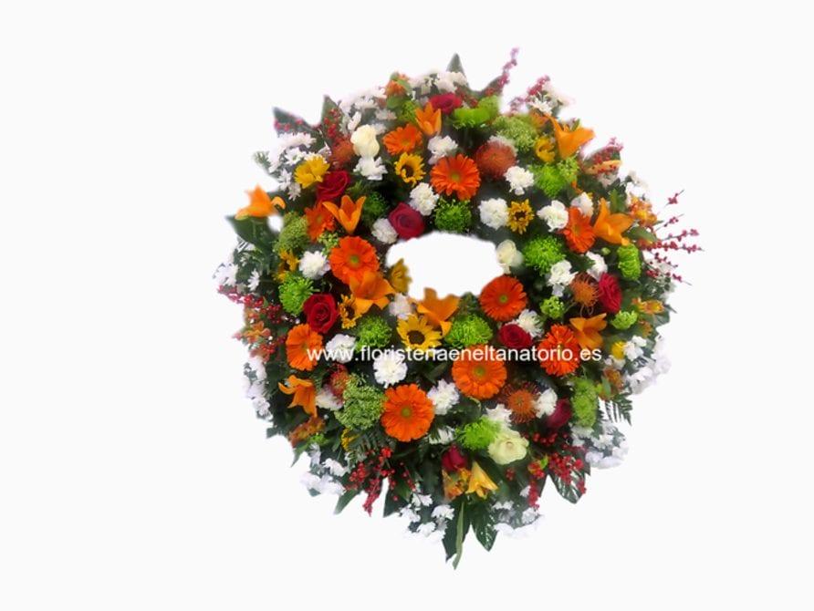 Corona floral con Lilium, Girasoles, Gerberas, Anastasias, Rosas y Margaritas.